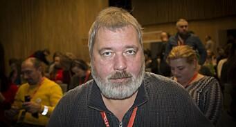 Seks av Dmitrys ansatte er drept på jobb. Nå har redaktøren for Novaja Gazeta kjøpt inn våpen for å beskytte journalistene sine