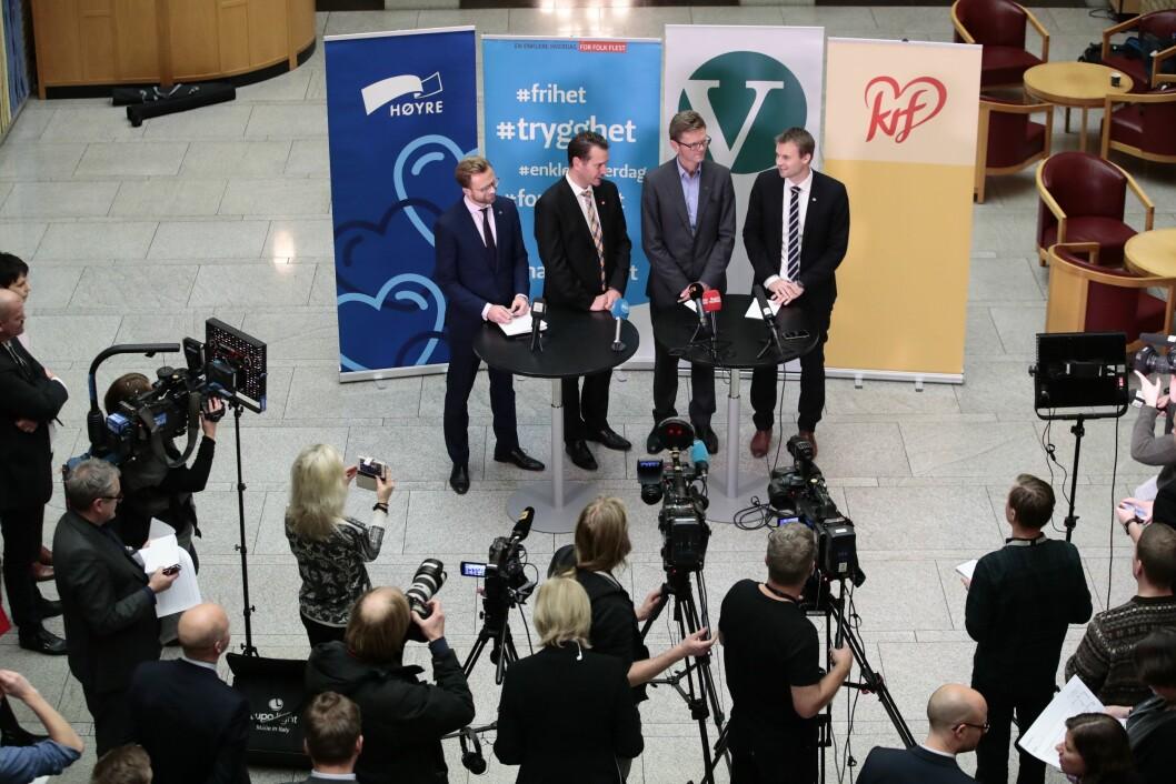 De finanspolitiske talsmennene Nicolai Astrup (H), Helge André Njåstad (Frp), Terje Breivik (V) og Kjell Ingolf Ropstad (KrF) holder pressekonferanse i Stortingets vandrehall etter at de kom til enighet i budsjettforhandlingene onsdag.