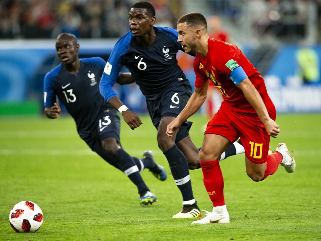 Frankrike - Belgia (1-0). Frankrikes N'Golo Kante (t.v.) og Paul Pogba løper etter Eden Hazard i VM-kampen i fotball mellom Frankrike og Belgia på Sankt Petersburg Stadion.