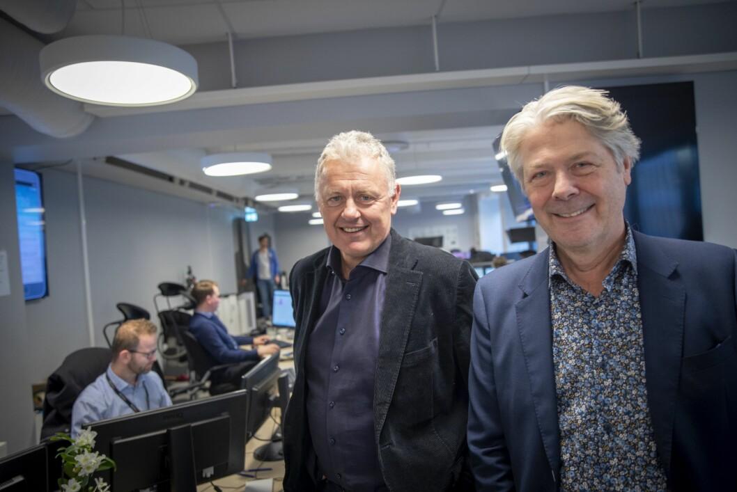 Nyhetsredaktør Erik Stephansen og sjefredaktør Gunnar Stavrum i Nettavisen. I bakgrunnen i front: Frontsjef Morten Karlsen.