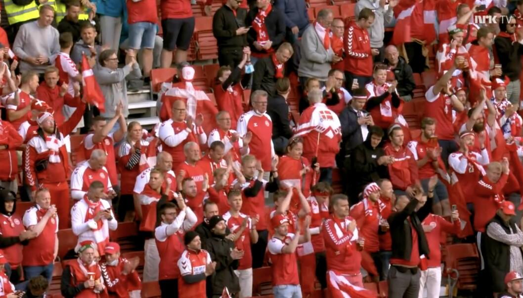 Danske supportere ble vitne til dramatiske scener da Christian Eriksen kollapset på banen og måtte få legehjelp.